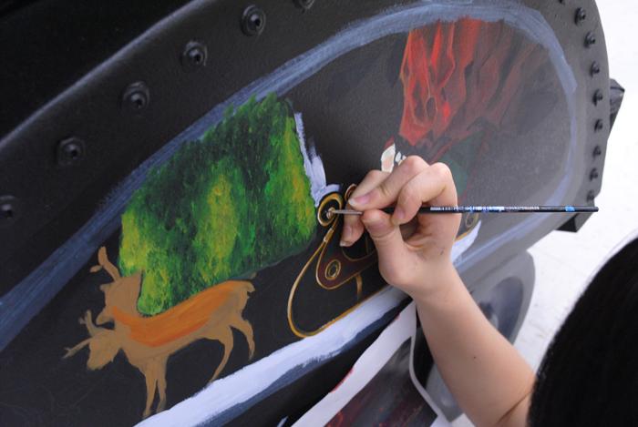 AP Studio Art students paint train sculptures for charity