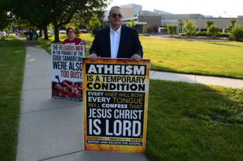 Demonstrators gather around Naperville Central, express beliefs on abortion issues