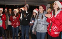 Girls cross country brings music to the holiday season
