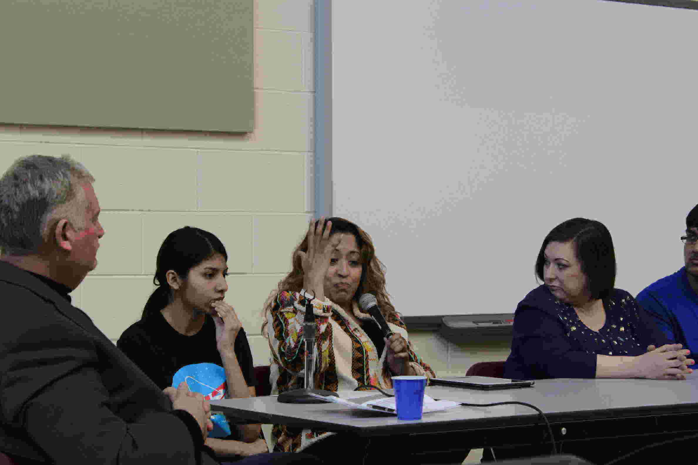 """From left: Moderator H. Ali Yurtsever, North student Denise Rodriguez, Youth Engagaement Manager Celina Villanueva and Senior Resettlement Manager for World Relief DuPage/Aurora Alison Bell discuss their thoughts on immigration. """"It isn't about being pro or against immigration and people coming into this country, it is about humanity and values,"""" Villanueva said. """"It is about saying we have a broken immigration system that when you say 'okay, well they can go to the back of the line' — there is no back of the line."""""""
