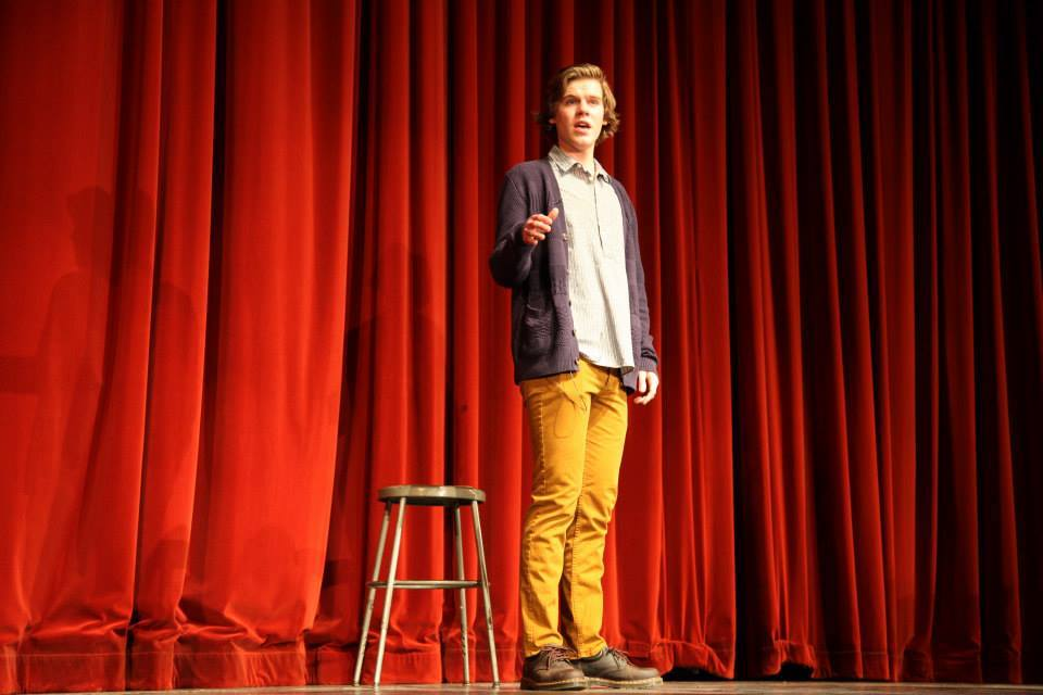 Carl Sladkey recites a poem he wrote himself for his talent act during Mr. NCHS.