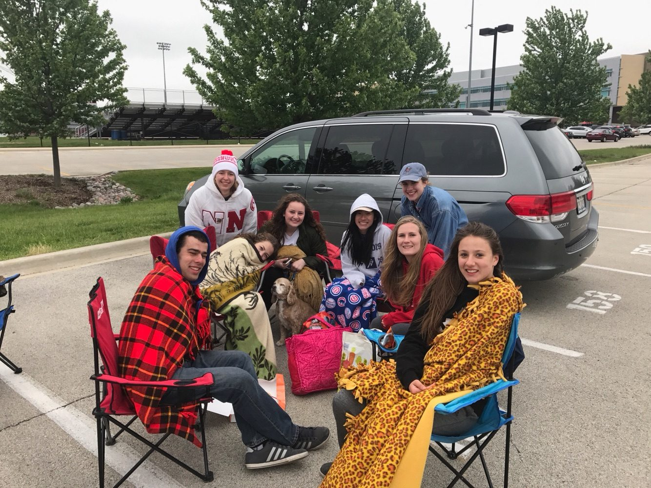 Seniors Aaron Gearhart, Rachel Damge, Anna Loveless, Angela Adamo, Max the dog, Lauren Kainrath, Jane Szymanski, Virginia Aabram and Mary Kelly sit in the senior lot, blocking parking spots and preventing underclassmen from parking.