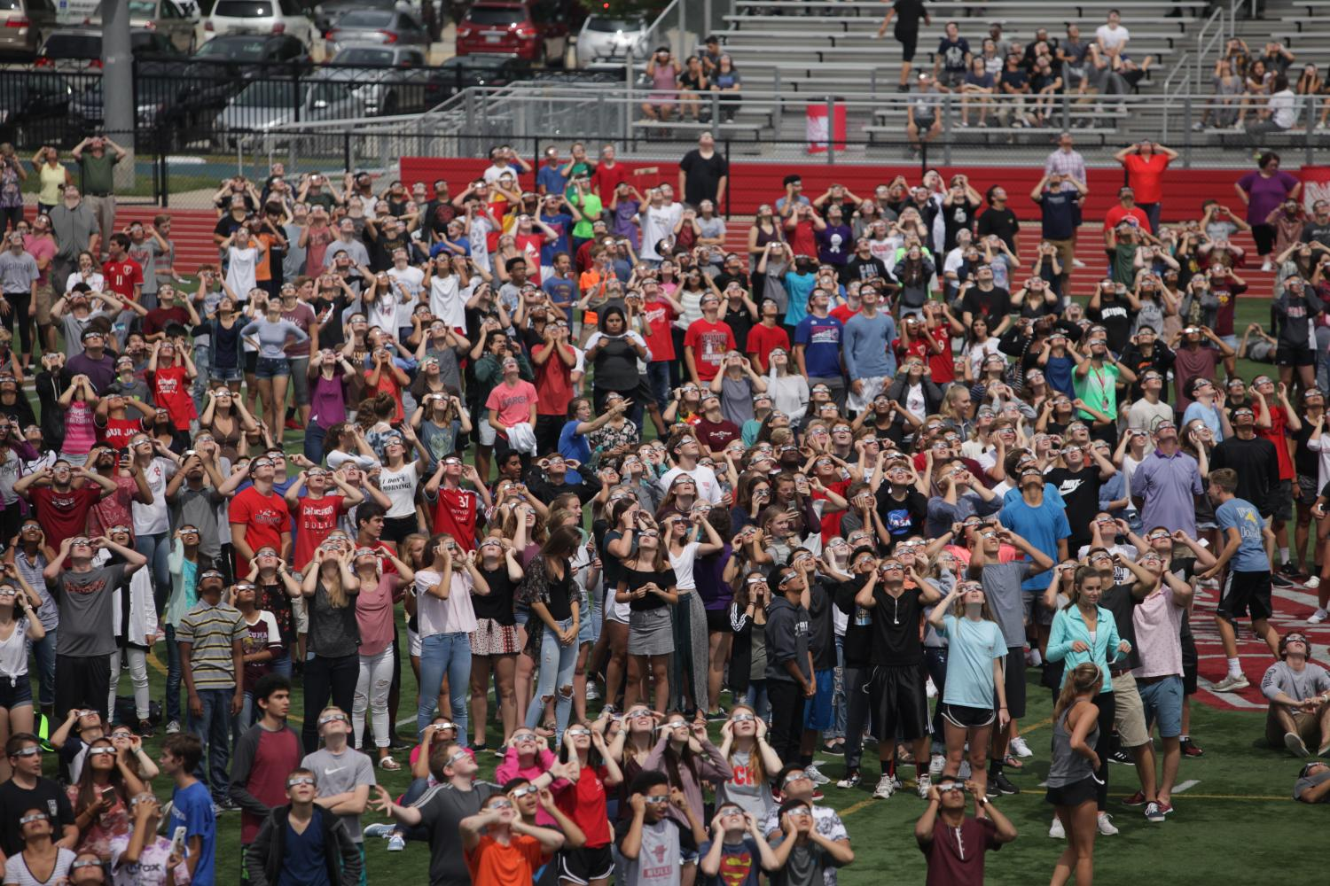 Central+students+gather+on+the+football+field+to+view+the+eclipse+on+Aug.+21.