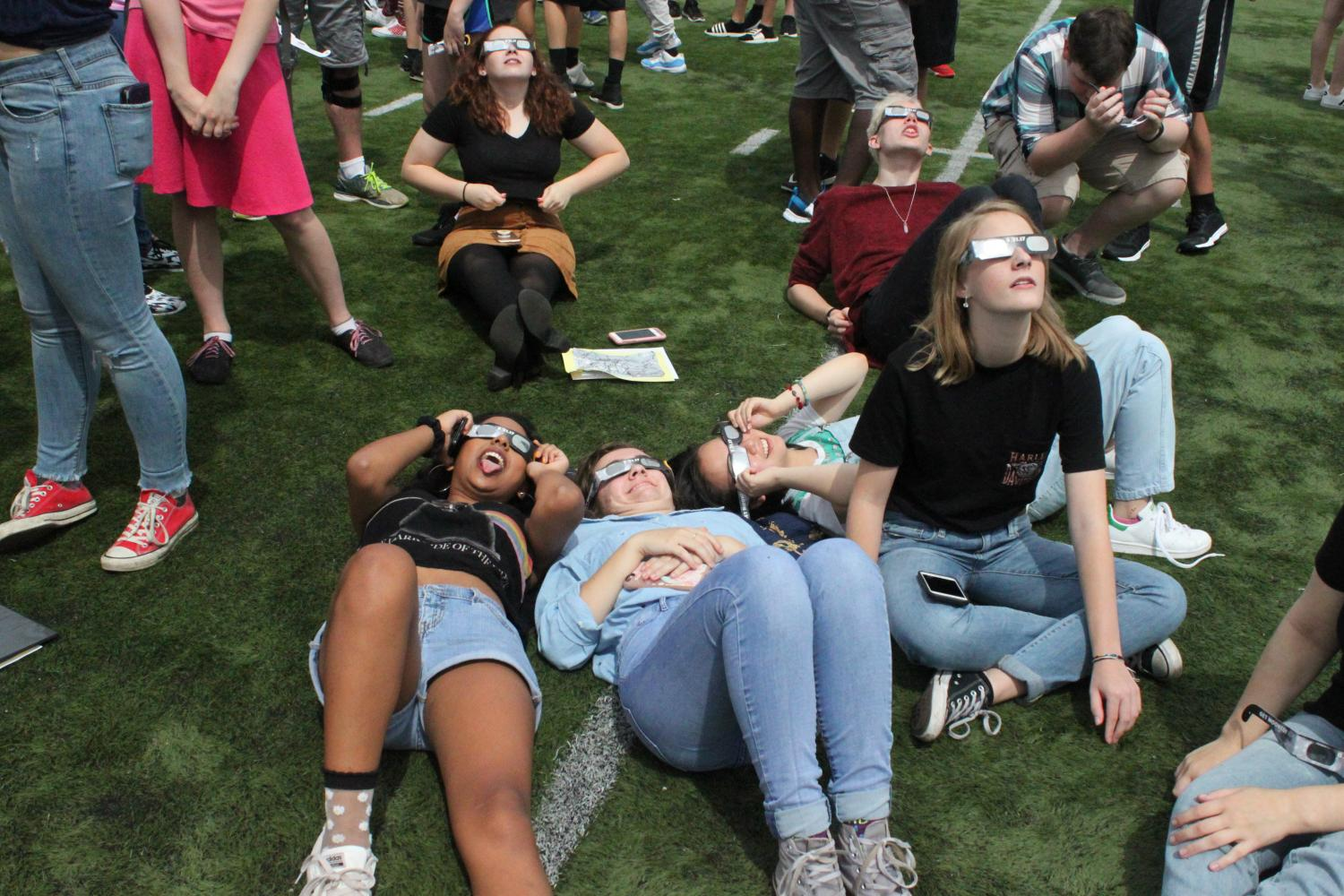 Central students gather on the football field to view the eclipse using the special eclipse glasses purchased for them by Home and School