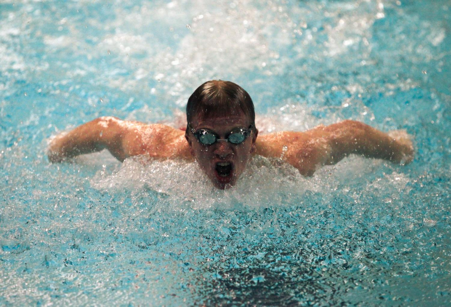 Junior Jonah Klein-Collins completes the fly lap of the 200 IM at the home meet versus Nequa Valley on Dec. 12.