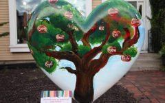 Sculpture heart painted by art teacher and Central students will be on permanent display in Honor Garden