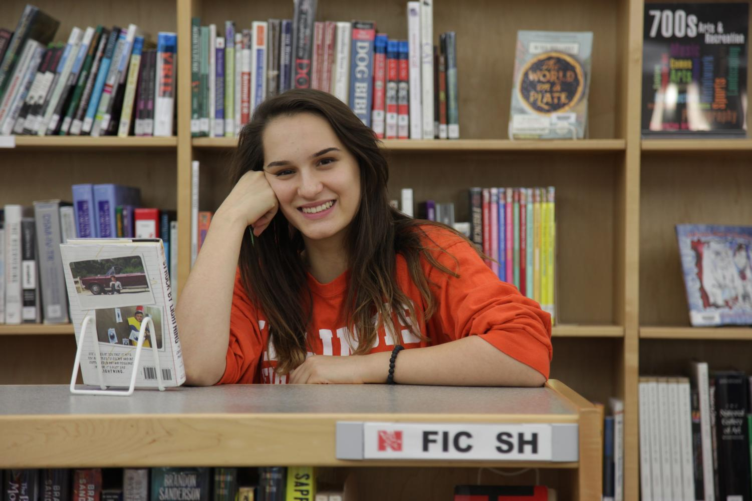"""When it comes to reading, Schramm covers all bases. """"From young adult fiction to dystopian to autobiographies, I don't have a typical genre,"""" Schramm said. """"I like a lot of different books."""""""