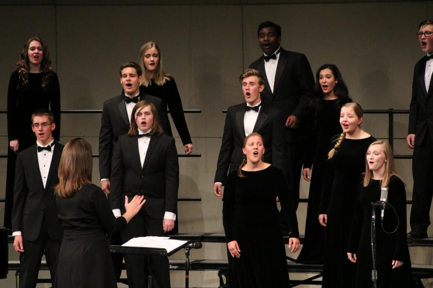 Members of the advanced choir perform at the fall choral concert on Oct. 16.