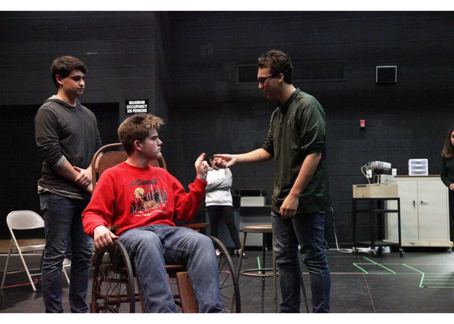 "Seniors Ryan Renc and Ethan Smith and sophomore Jake Clements rehearse for ""The Man Who Came to Dinner."" Performances are Nov. 1-3 in the auditorium."