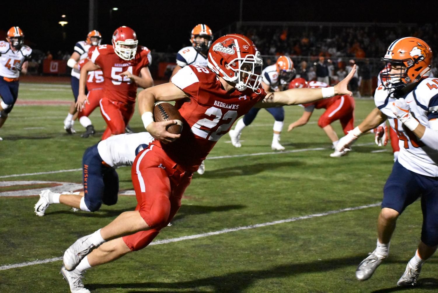 Senior Danny Hughes blocks Sean Doyle at the home game against Naperville North on Sept. 7.