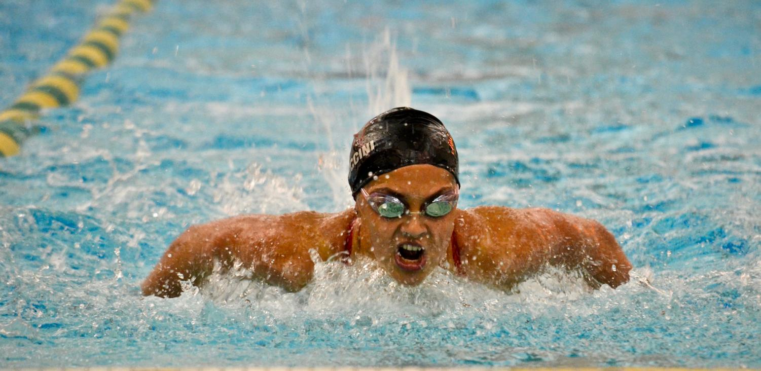Alexa Puccini swims the 100-yard butterfly on Oct. 11 at Waubonsie Valley.