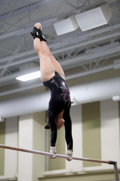 Senior Maddie Surin competes on the uneven bars at a home meet during her sophomore year.