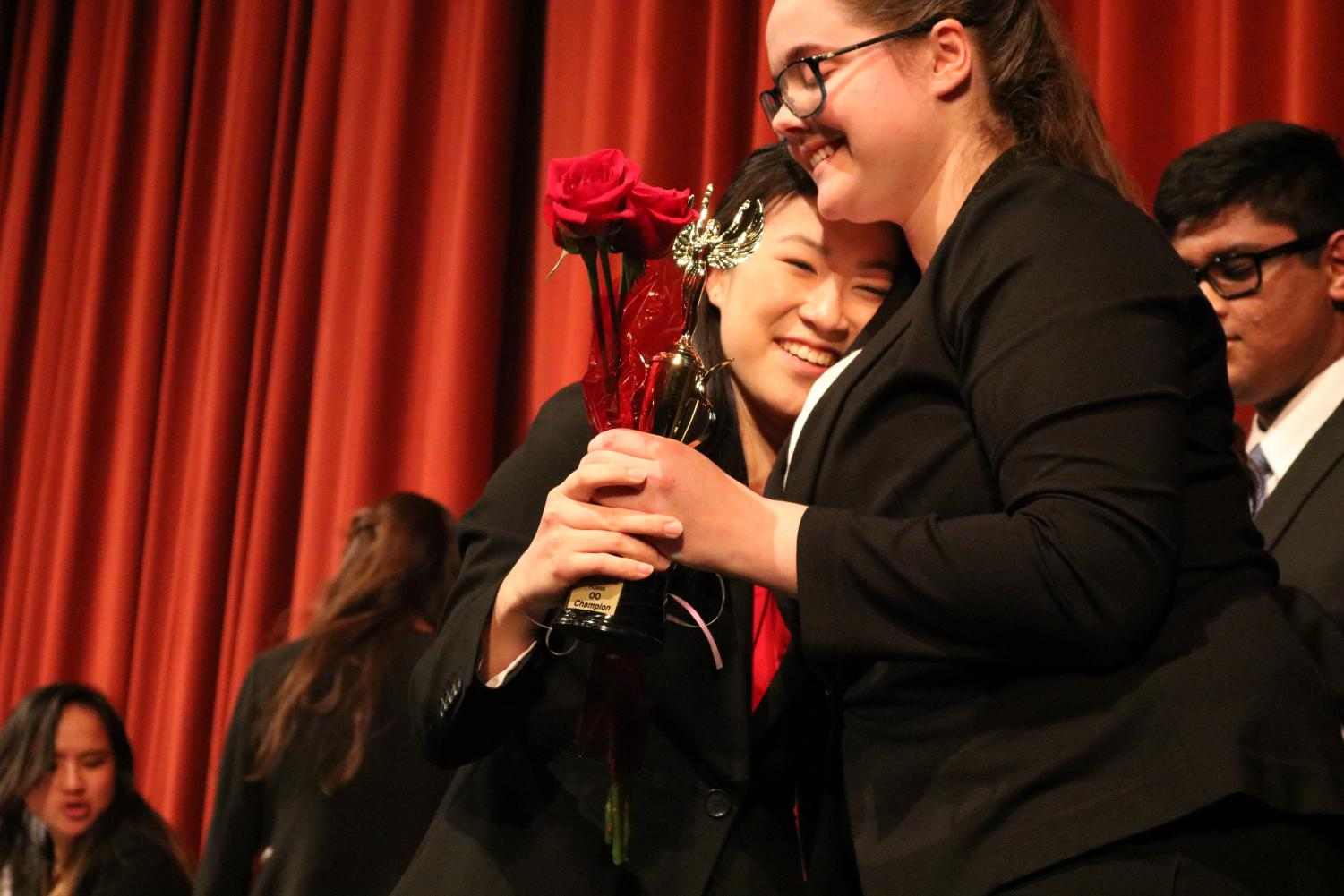 Junior Michelle Kee is presented with an award and rose after winning first place in Original Oratory during the Tournament of Roses on Dec. 8.