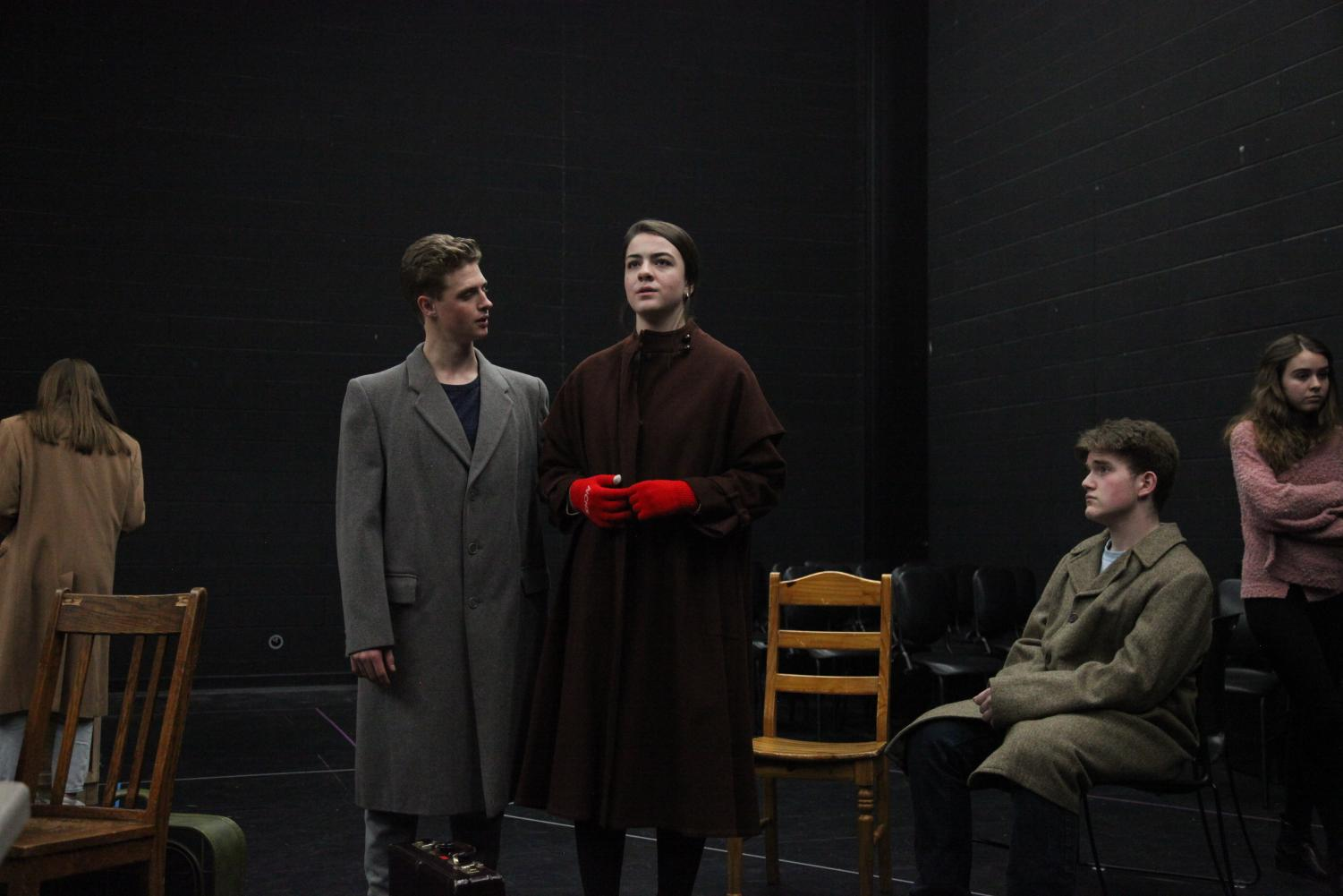 "Seniors Payton Nesci, Nora Lullo and Ethan Smith rehearse in the black box theatre for the Holocaust drama ""The Diary of Anne Frank."" - Photo by Madeleine Chan"