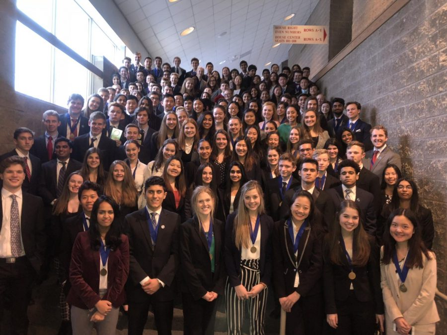 DECA+students+posed+for+a+photo+on+Jan.+23+at+Naperville+Central+after+regionals+in+Rosemont%2C+IL.%0A