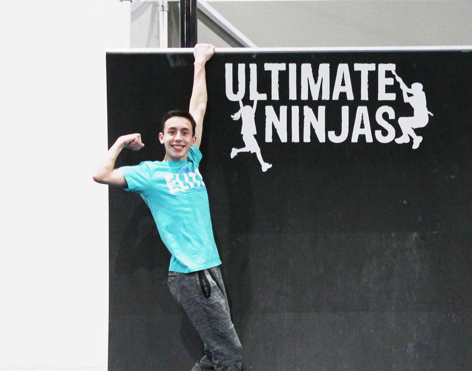 "Photo by Ellen Spencer  Sophomore Aaron Orth trains at the Ultimate Ninjas gym in Naperville. ""I try to go to as many local [competitions] as possible,"" Aaron said. ""If I have a break in school, I like to go somewhere for them. It turns into a ninja-cation."""