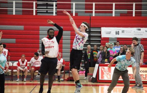 Students compete against staff in annual  basketball game for charity