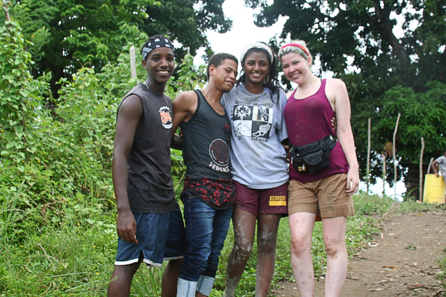 "Poola (second from right) volunteering with locals in the Dominican Republic in 2017. ""The purpose [of volunteering] is not to go there and take pictures with the kids or to feel like you're better than them in some sort of way,"" Poola said. ""You really want to break down that Western savior complex and go in to change your own perspective and mind."""