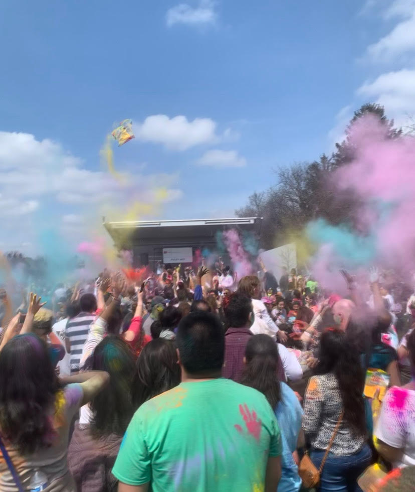 Locals came together and threw colored powder at the Holi celebration in Centennial Park on April 6.