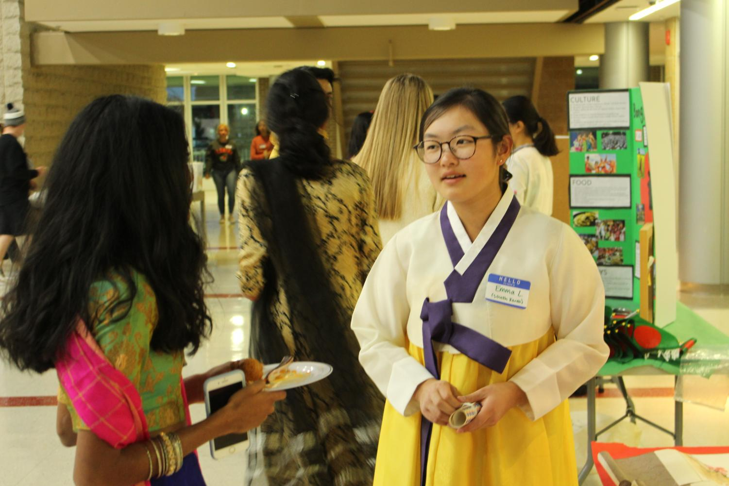 Senior Emma Lim presents at the South Korea booth.