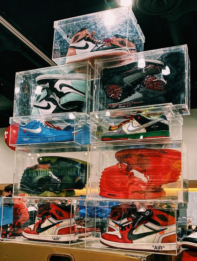 Sneakers are stacked at Sneaker Con.
