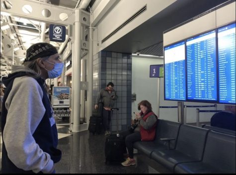 A traveler at O'Hare International Airport wears a mask as he waits for his flight on Feb 13. Many are taking precautions against the spread of coronavirus.