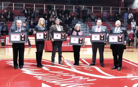 Left to right: Tom Best ('76), Gabrielle Blankenfeld ('86), Randy Kersten ('69), Coach Dottie Rizzuto, Curtis Malm ('96) and Giovanni Rizzo ('98) are honored at the Feb. 14 induction ceremony.