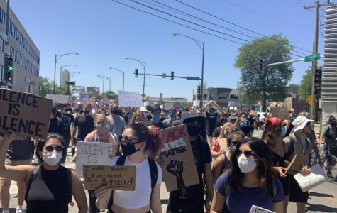 Protesters in Chicago hold signs and chant to demand justice for George Floyd and the black community