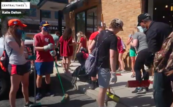 Naperville residents, including many high school students, assist with cleanup the morning after protests turned violent and over 30 city businesses were vandalized.