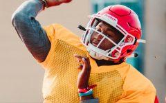 Senior quarterback Sam Jackson looks to make a pass at practice.