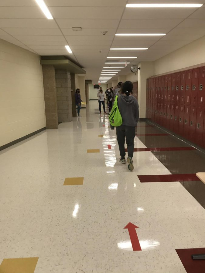 How will social distancing be enforced in hallways during passing periods as more students are brought back in Stage 3?
