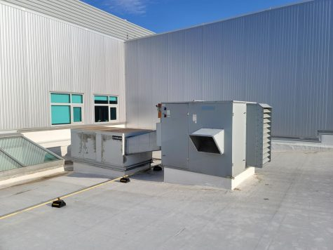 Modular energy exchange units across the roof of the building, like the one pictured above, are responsible for filtering and climate control in different areas of the school.