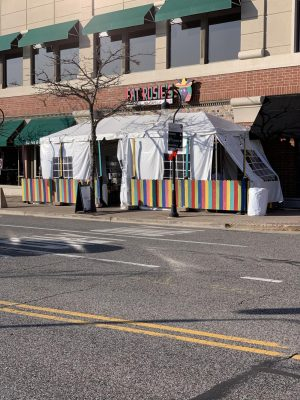 Many local businesses, like downtown restaurant Fat Rosie's, are looking for ways to weather the new restrictions' economic effects.