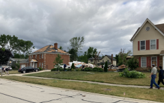 A tornado damaged many Naperville homes on the evening of June 20, completely destroying this home in the Ranchview neighborhood as the homes on either side sustained storm damage but were otherwise spared.