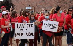 Educators, parents and students rally outside of the Washington Junior High School main entrance in support of the Naperville Unit Education Association's contract proposal on Aug. 2.