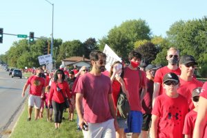 Educators, students and parents march from Naperville North to Washington Junior High in support of the NUEA's contract proposal on Aug. 16