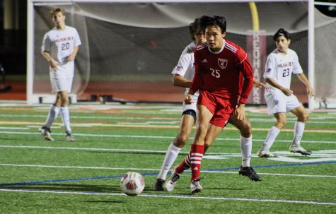 Naperville Central junior forward Nathan Kwon passes to a teammate.